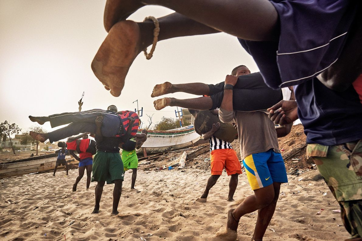 Young wrestlers train at the school of ex-Wrestler Boy Kaire at the Corniche in Dakar.