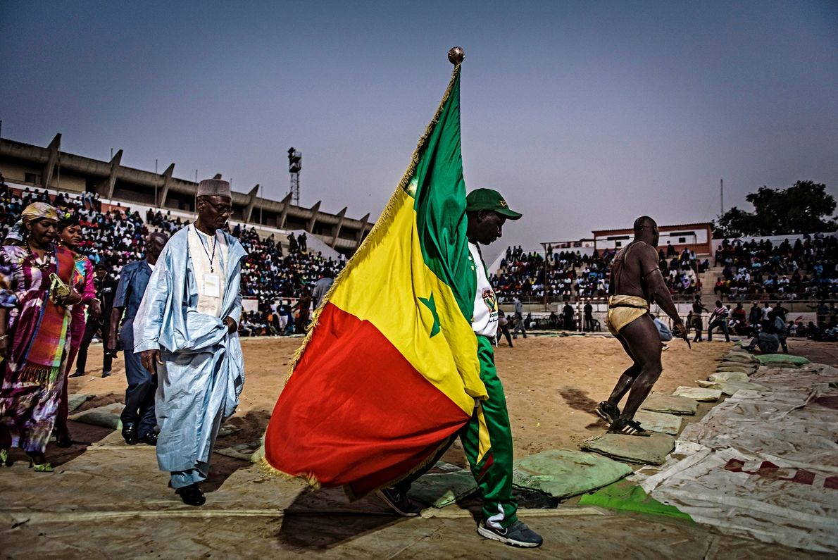Flag bearers carry the Senegalese flag through the Iba Mar Diop stadium in Dakar before the ...