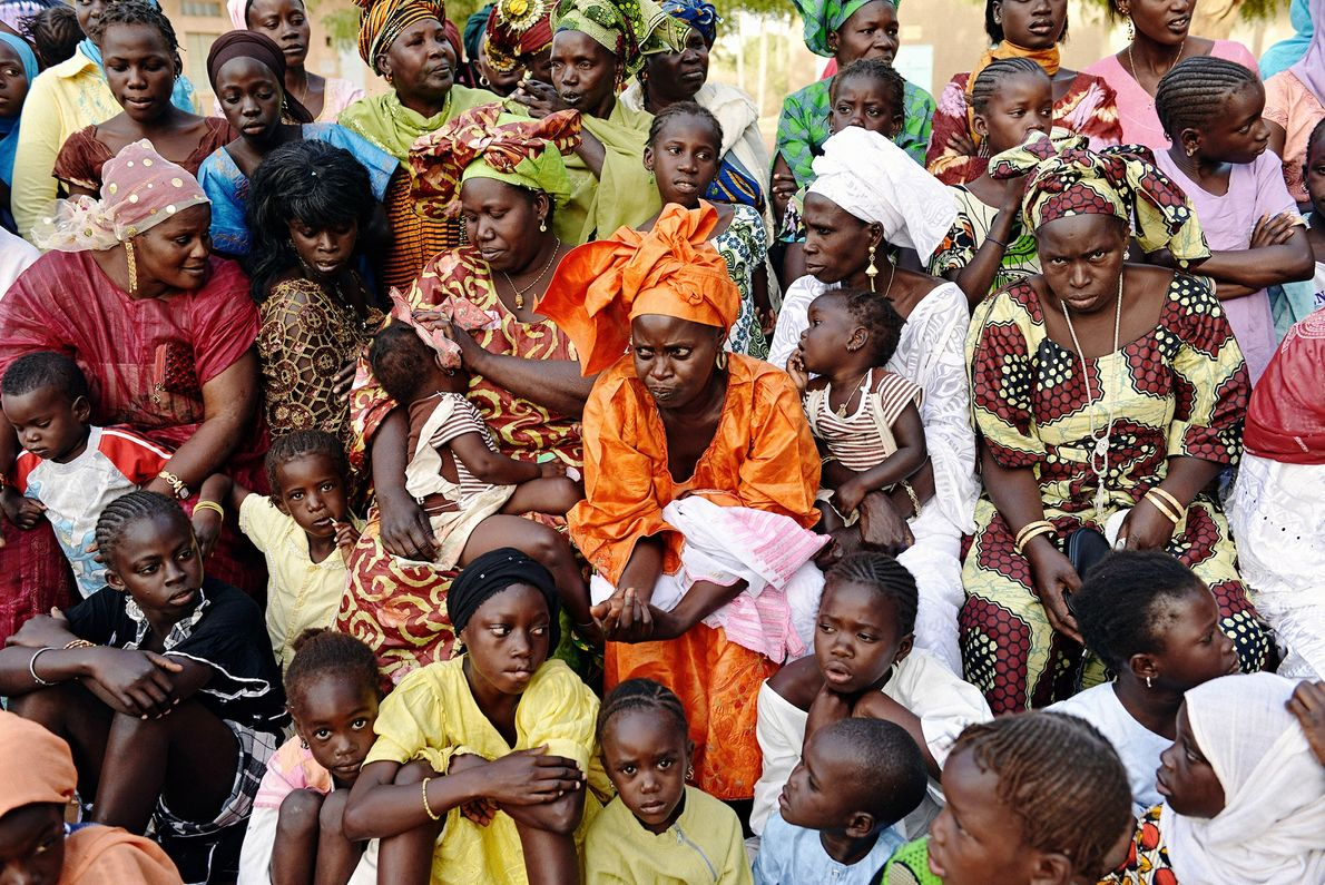 Women and children from the Senegalese village of Soune assemble to watch a wrestling match.