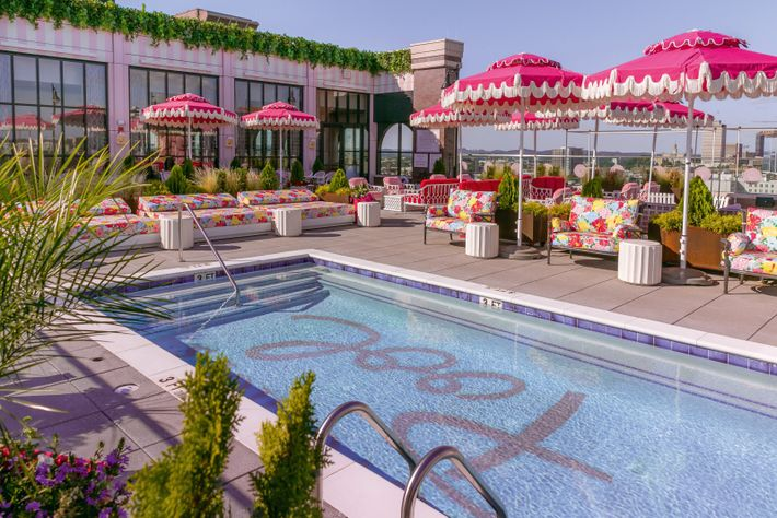 The rooftoppool and frilly fuchsia umbrellas at Graduate Nashville.
