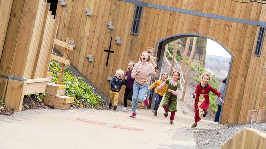 Children explore the new Robin Hood's Hideout playground.