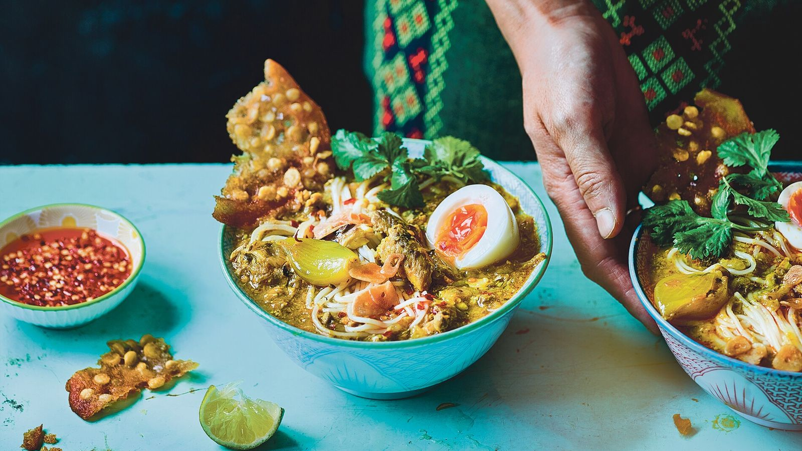 Mohinga, the national dish of Burma,is a fragrant lemongrass and fish soup with rice vermicelli, egg, ...