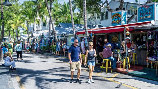 Colourful cafes and shops on Lazy Way, close to the waterfront in Key West.