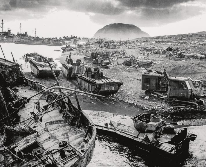 Equipment and supplies litter the island of Iwo Jima, scene of one of the bloodiest battles ...