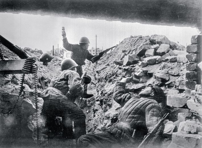 A fallen Soviet soldier still grips a hand grenade while another takes aim at German invaders ...