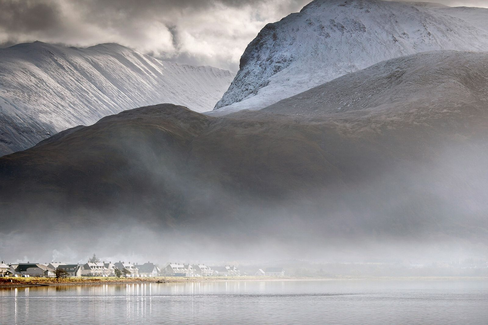 Ben Nevis towering above the village of Caol, near Fort William.