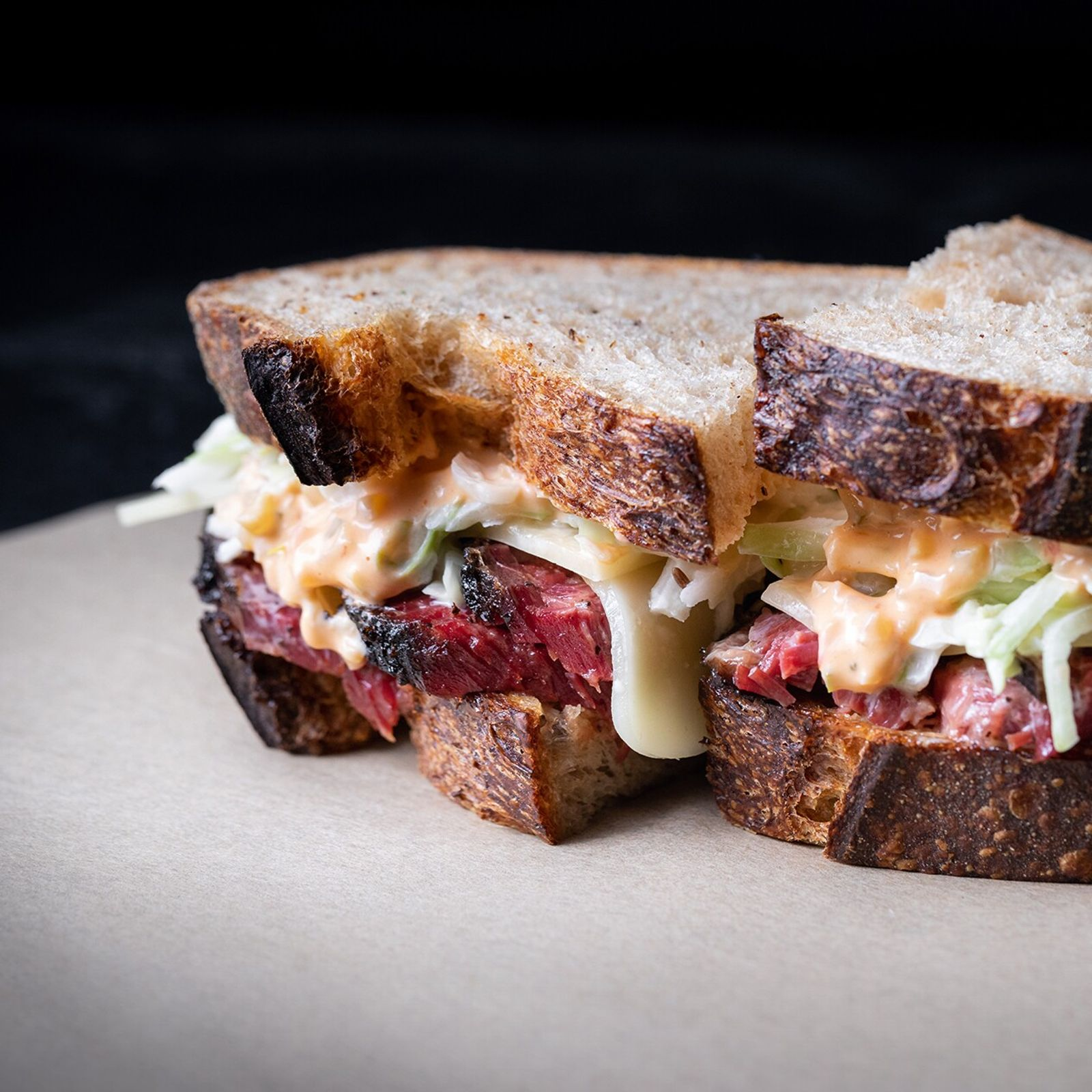 Pit-smoked pastrami sandwich, Ugly Drum.