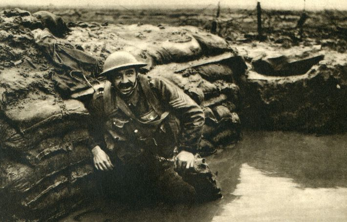 A British soldier rests in a waterlogged trench in Belgium. Archaeology is revealing the efforts soldiers ...