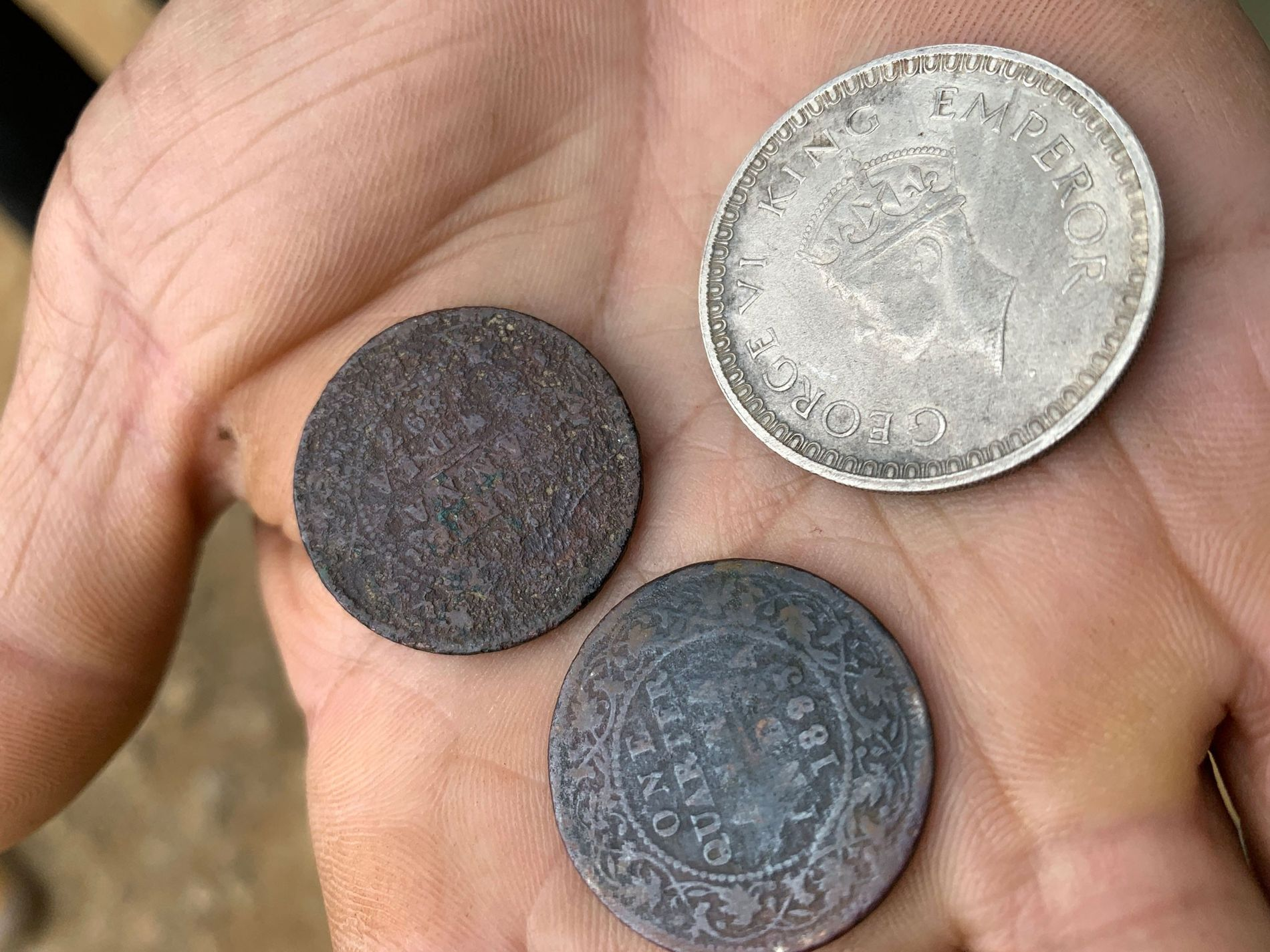 Old coins, including some dating from the World War II era, have been found in the ...