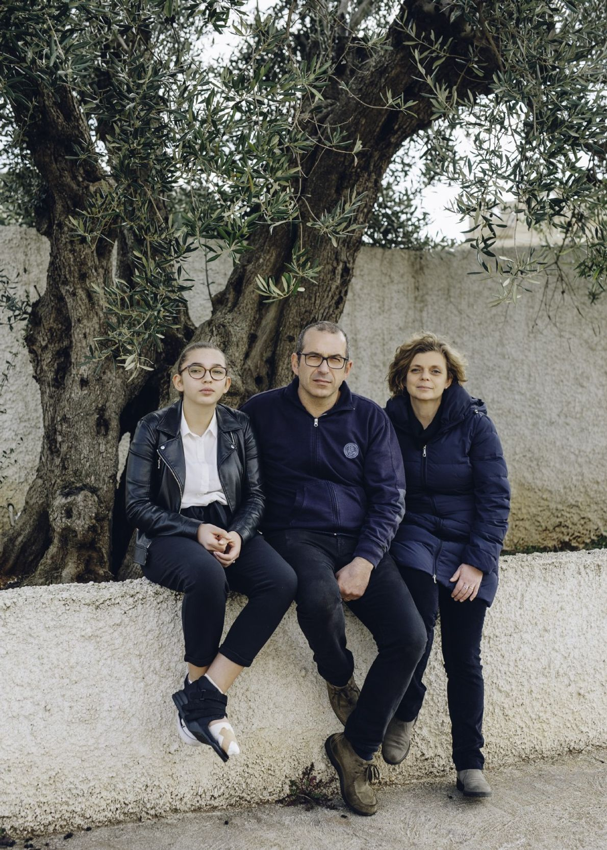 Giovanni and Daniela Melcarne, seen here with their daughter Daria at their olive mill in Gagliano ...