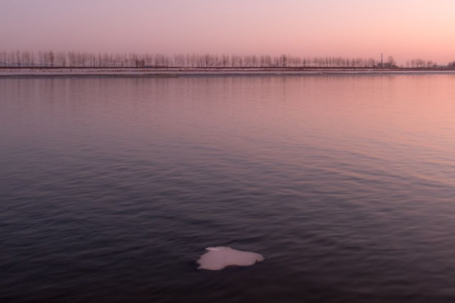 A small patch of ice floats in the Yalu River.