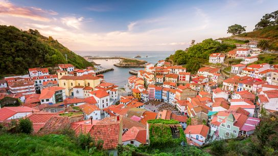 Known for brightly painted cliffside houses above a sparkling marina, the fishing village of Cudillero is ...