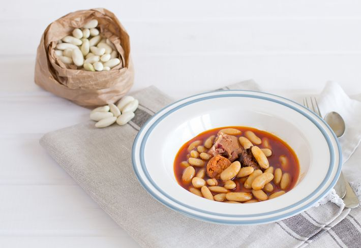Fabada asturiana is the signature dish of the region, a rustic stew of white beans and ...