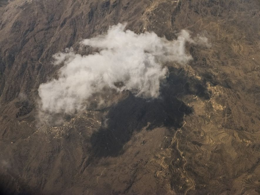 A cloud hovers over mountainous northern Yemen. North and south Yemen were unified in 1990, but ...
