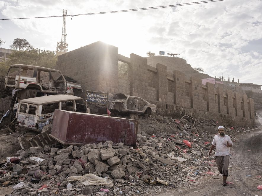 A man walks through Ad Dali, a southern city that has been fought over by Houthi ...