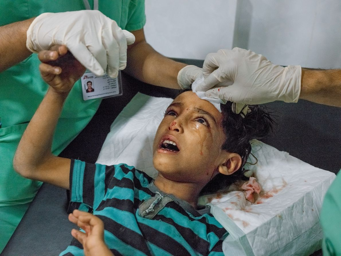A seven-year-old boy hit by shrapnel from an explosion is treated by Doctors Without Borders in ...