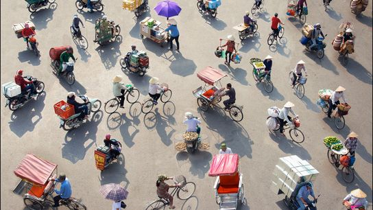 Hà Nội, Ha Noi, Vietnam  Pedalling through the city from early morning through late night, bicycles weighed ...