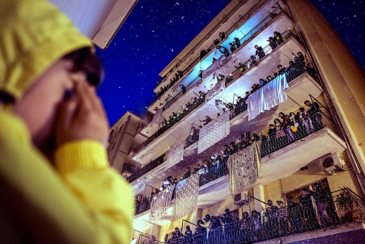 Pagani, Italy  Each Easter, residents of Pagani, Campania drape their best sheets from balconies and throw pieces ...