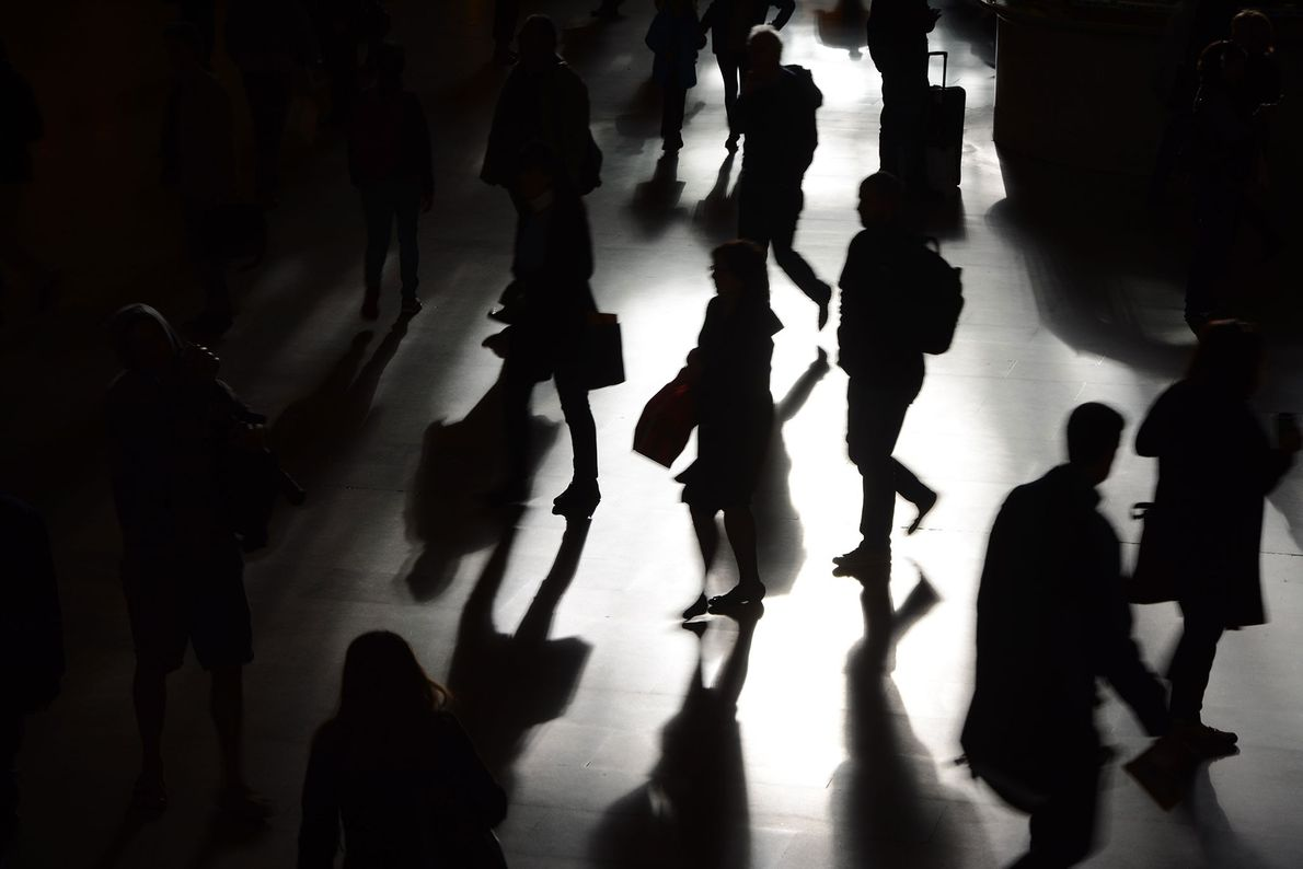 New York, New York  The silhouettes and shadows of commuters passing through Grand Central Station transform an ...