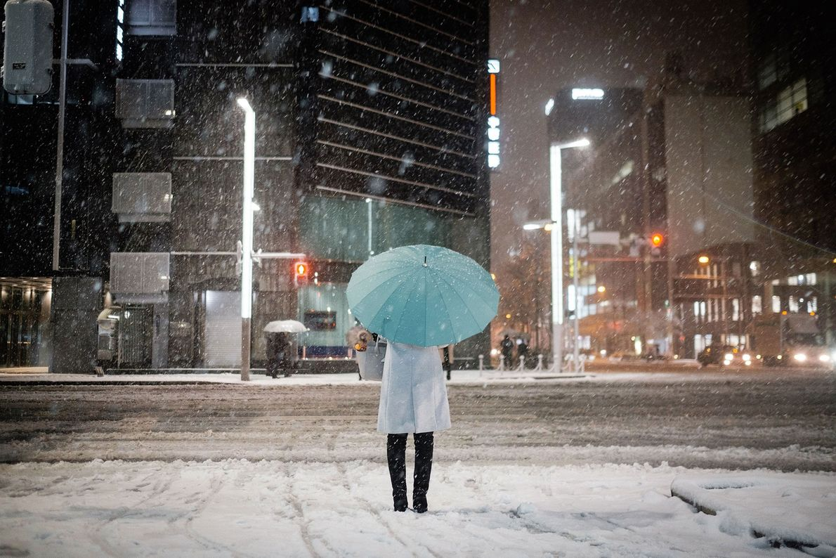Tokyo, Japan  The always-bustling streets of Tokyo are at their calmest on snow-blanketed winter nights. This is ...