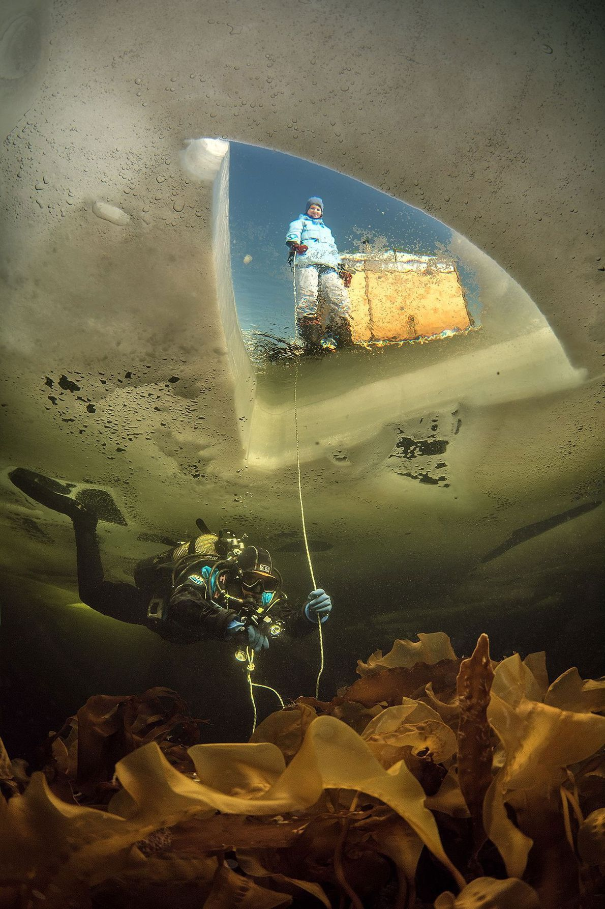 """This image, taken under Arctic Russia's frozen White Sea, is named """"Two Worlds."""" Viktor Lyagushkin says ..."""