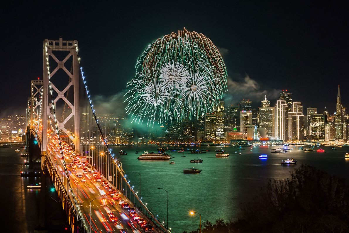 San Francisco As New Year fireworks explode in a clear sky over San Francisco Bay, their bright ...