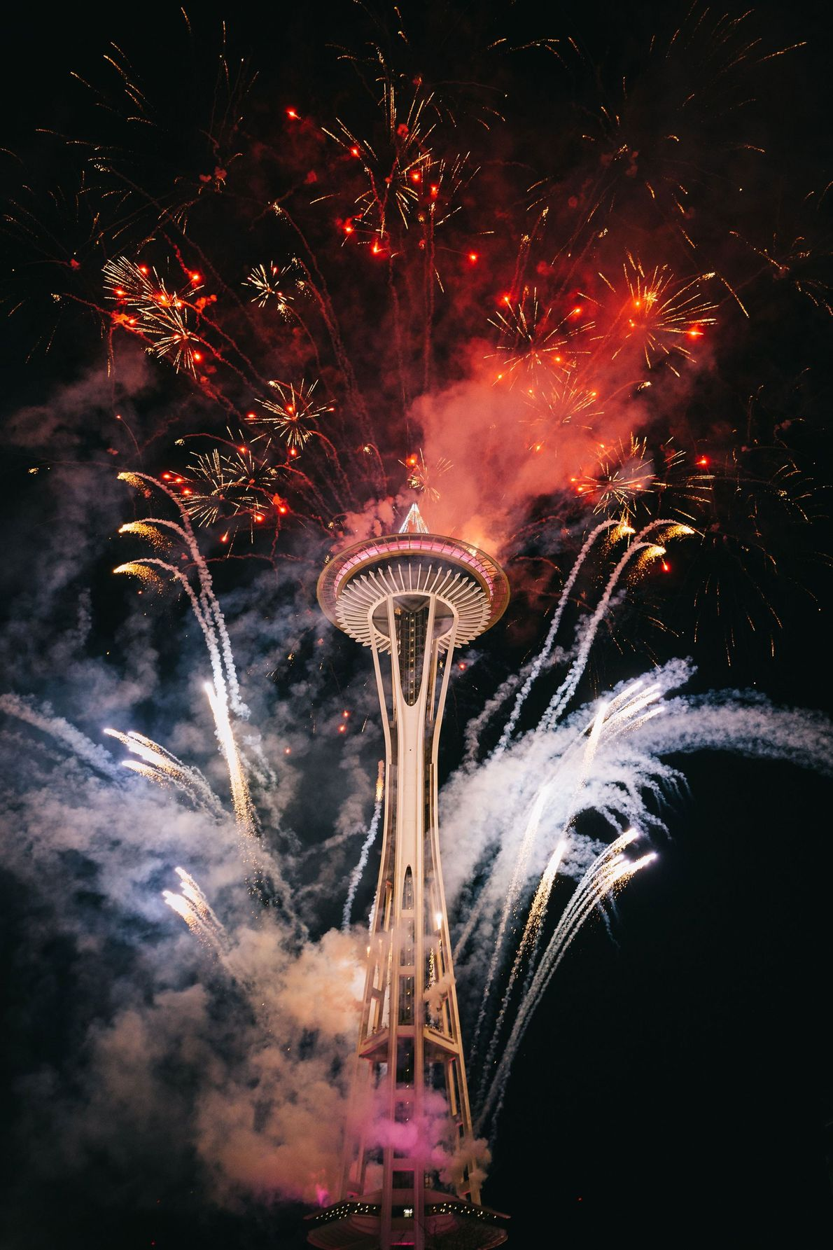 Seattle Captured on a recent New Year's Eve, rockets shooting from the sides of Seattle's Space Needle ...