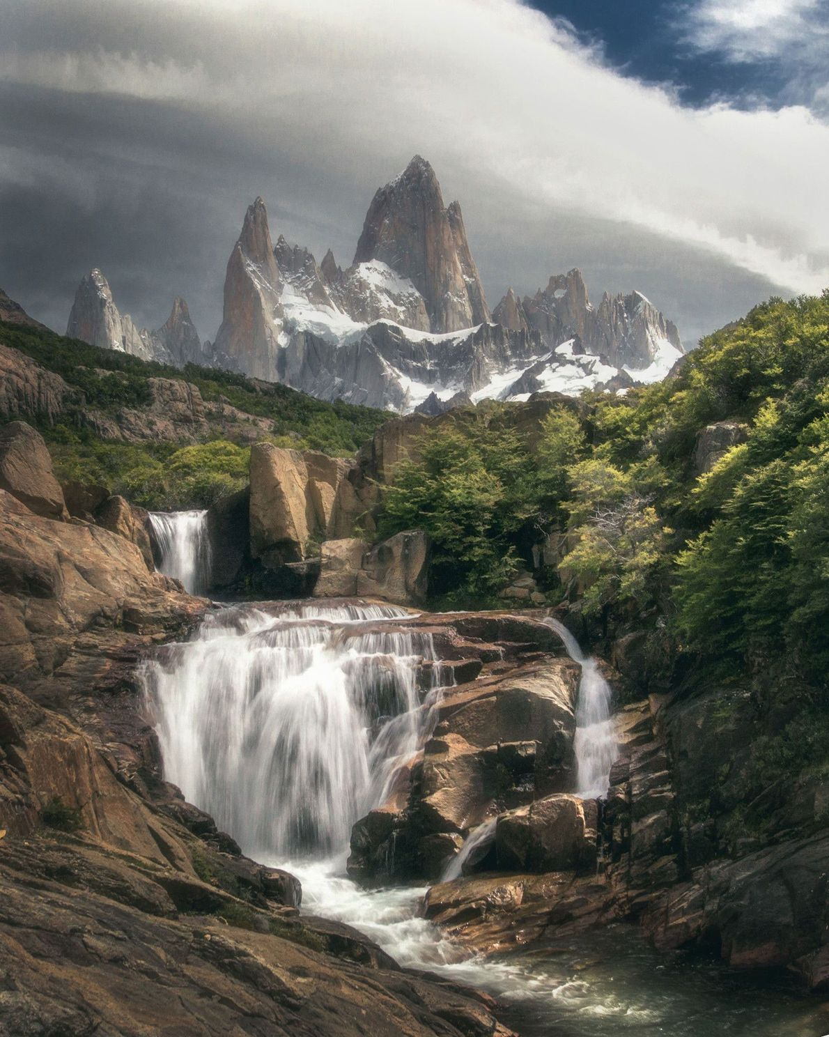 Moody weather shadows a cataract in Patagonia.