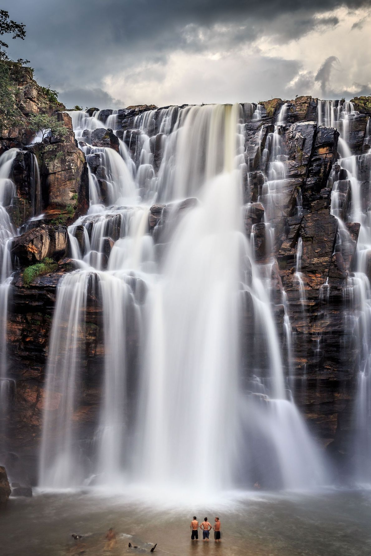 """Faced with tourists swimming at the base of the 230-foot-tall falls, photographer Victor Lima says """"I ..."""