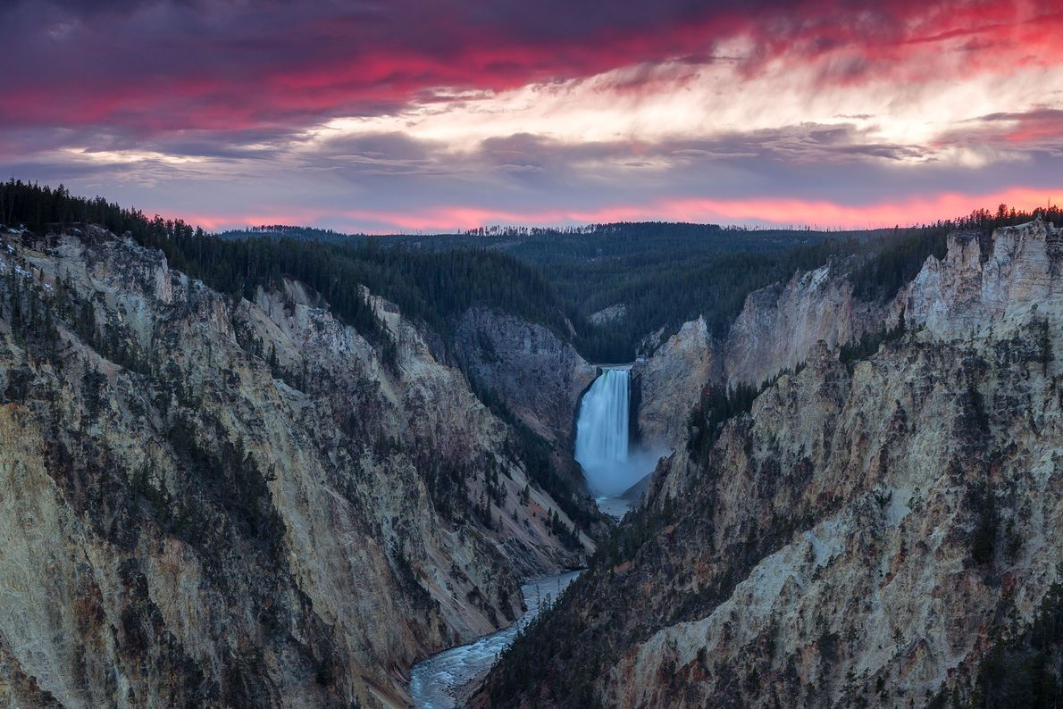 Colorful clouds roll over the falls, seen from the popular South Rim overlook known as Artist ...