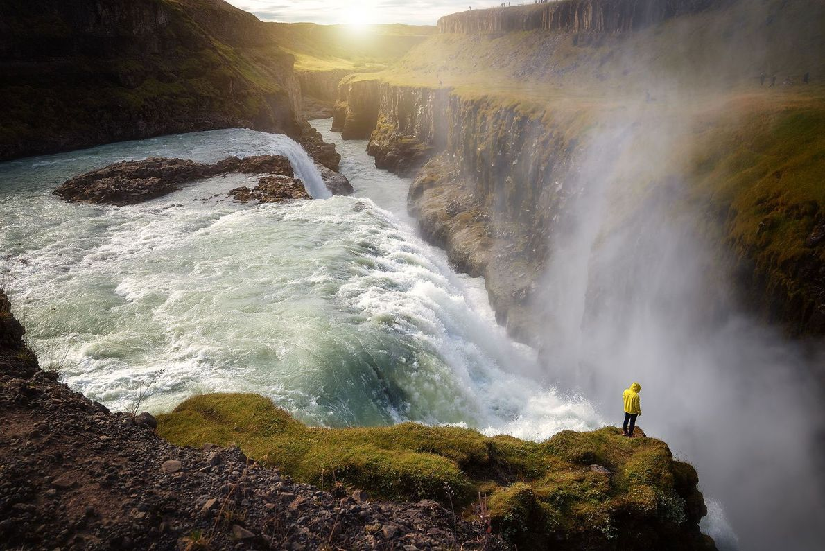A visitor gazes into the gorge formed by this powerful waterfall in southern Iceland.