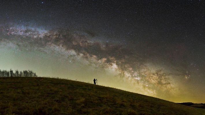 A photographer sets up under the stars in Hungary's Zselic National Landscape Protection Area.